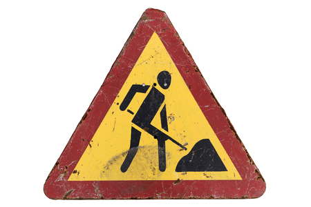 Old dirty rusty scratched triangular red border yellow road sign 'Road works'. Stock Photo