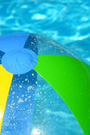 children party: beach ball in the pool fresh water