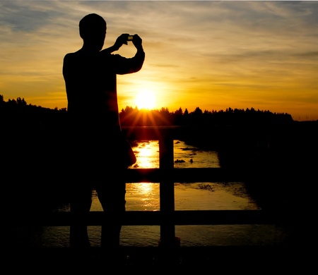 A person on a bridge taking a photo Stock Photo - 8809844