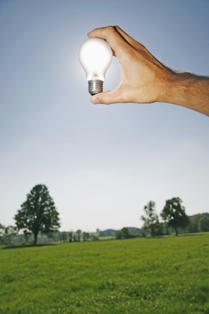 electric bulb against the sun as a symbol for solar energy photo