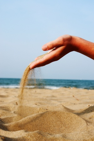 sand running through hands as a symbol for time running, lost etc............. 版權商用圖片