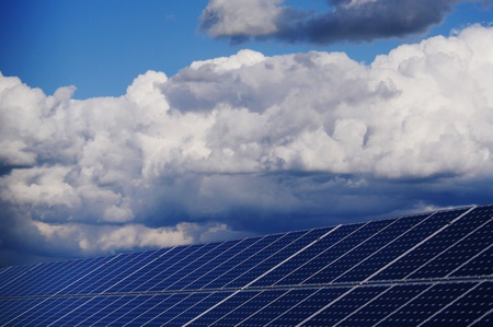 solar collector energy plant outside against sky photo