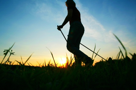 nordic walking: close-up of some people doing sport outside Stock Photo