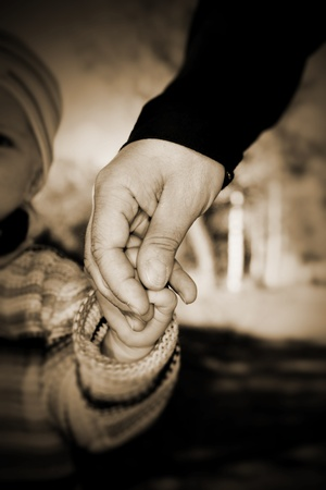 Guidance through the world. Holding hand of a child to guide it.............