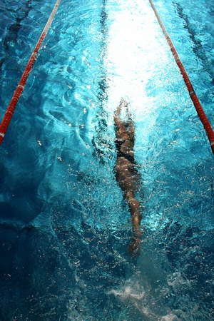 exertion: Swimmer in a swimming pool on a hot day Stock Photo