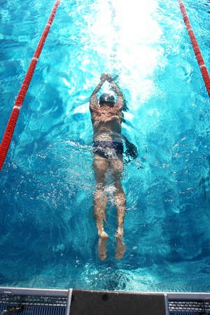 swimmer: Swimmer in a swimming pool on a hot day Stock Photo