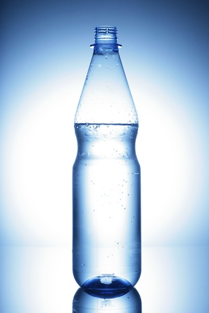 water bottle on a shiny surface in studio photo