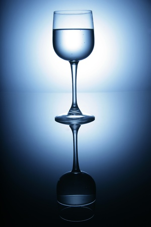 insipid: water glass on reflecting ground shimmering blue