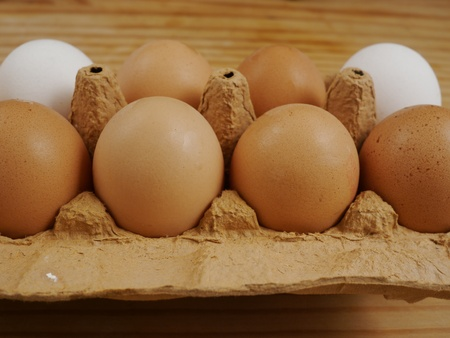 brown eggs on a wooden surface indoor photo