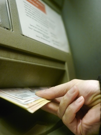 automatic teller machine bank: Finger using automatic teller keypad to enter pin number Stock Photo