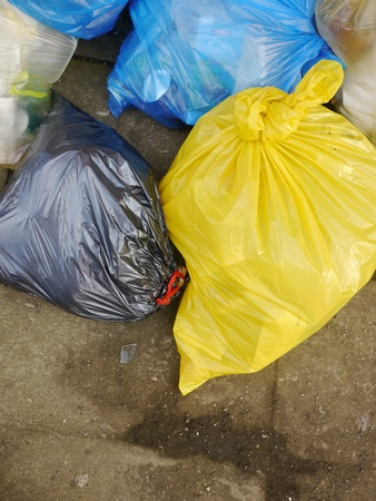 Many Garbage Plastic Bags With Different Colours Piled Up photo