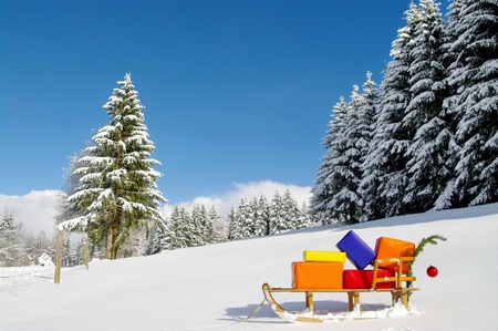 santa suit: colorful presents on a Santa Claus sledge in a winter landscape