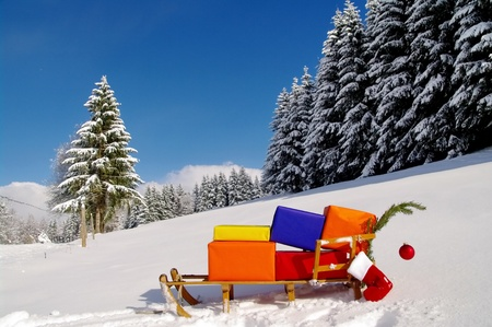 christmas sleigh: colorful presents on a Santa Claus sledge in a winter landscape