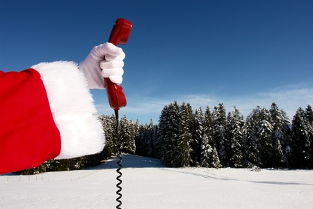 tree service business: Santa Claus Hotline symbolized by a red retro phone Stock Photo