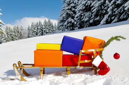 colorful presents on a Santa Claus sledge in a winter landscape Stock Photo - 10835837