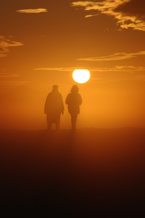 lonesome: a couple have a walk through a misty landscape