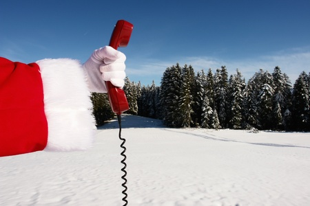 retro phone: Santa Claus Hotline symbolized by a red retro phone Stock Photo