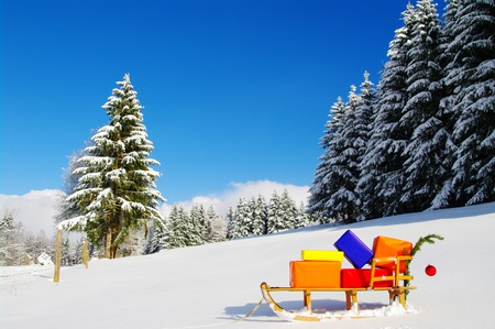 colorful presents on a Santa Claus sledge in a winter landscape photo