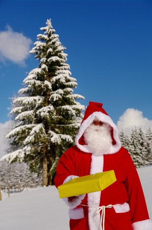 kris kringle: Santa Claus, Father Christmas delivers presenting present Stock Photo