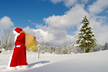 kris kringle: Santa Claus, Father Christmas in a beautiful winter landscape Stock Photo