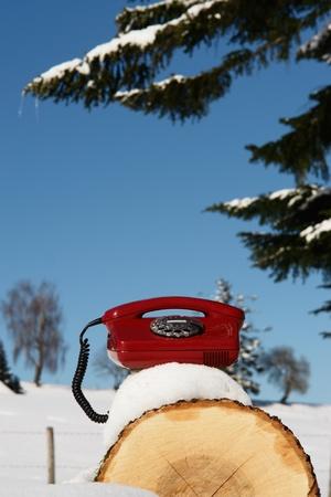 Santa Claus Hotline symbolized by a red retro phone Stock Photo - 10835848