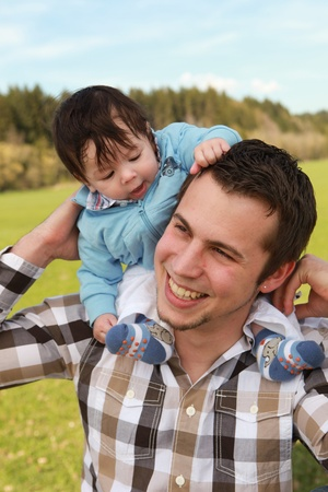 A young happy father 25 years with his 4  month old son. Stock Photo - 10875035