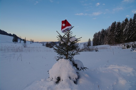 red santa claus hats in a snowy landscape Stock Photo - 10921710
