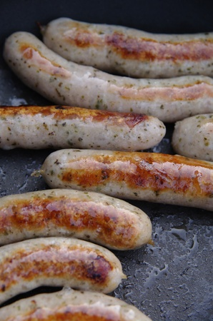 a sausage grilled on a camp fire photo