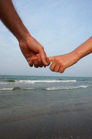 las manos en la playa ............