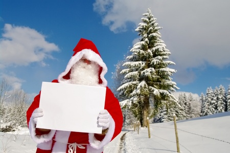 Santa Claus, Father Christmas holding blank sign photo