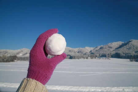 happy snow ball fight in winter time photo