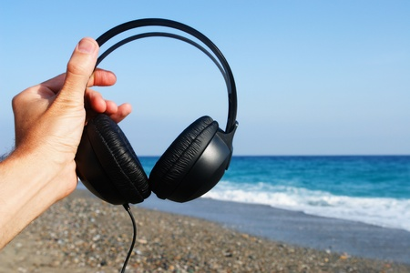 blue and black headphones over a white background photo