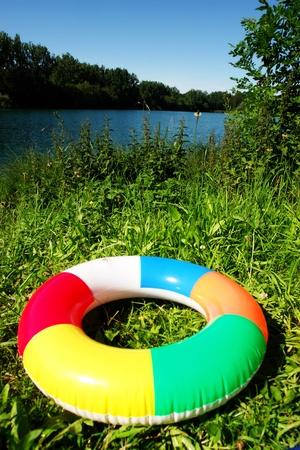 taking the plunge: swim ring floating on beautiful blue lake Stock Photo