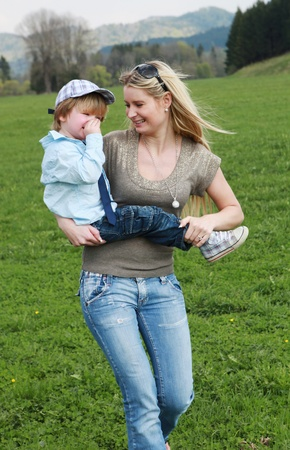 mother and son having fun outdoors in the meadow Stock Photo - 11119126