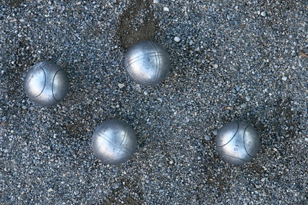 bocce ball: silver boccia ball on the ground