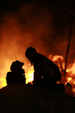combust: Close-up of some people coming out of fire Stock Photo