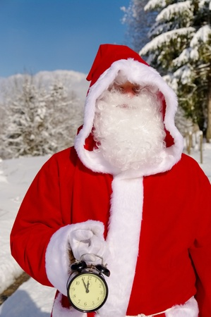 Santa Claus, Father Christmas holds watch clock photo
