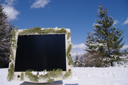 a decorated screen in snowy winter landscape photo