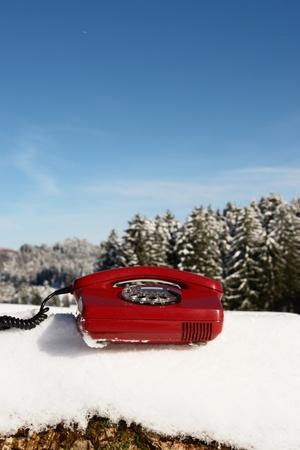Santa Claus Hotline symbolized by a red retro phone Stock Photo - 11119232