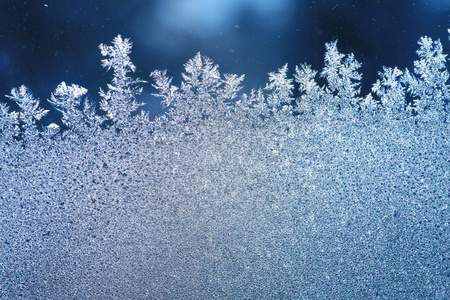 winter thaw: The patterns made by the frost on the window (hoarfrost background) Stock Photo