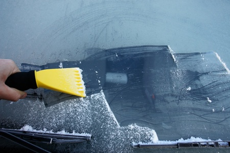 windscreen wiper: car windshield covered with ice and snow
