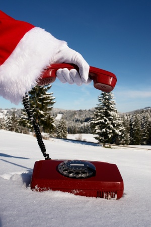 Santa Claus Hotline symbolized by a red retro phone Stock Photo - 11119311