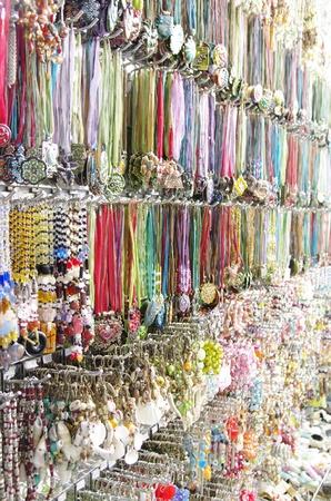 many  jewel bracelets in an outlet photo