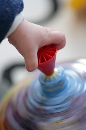 spinner: Child hand on spinner in motion