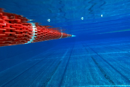 underwater view from a swimming pool with red marking
