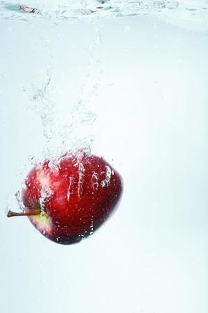 to watersplash: apple watersplash Stock Photo