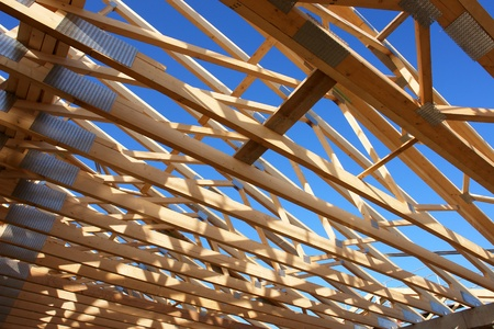 rafter: wood roof at a building site...........