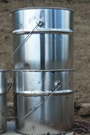 metal silver cans on ground on a building site photo
