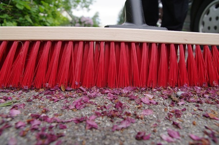 clean street: sweeping the sidewalk with a broom
