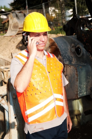 buildingsite: Close-up of a worker making a call